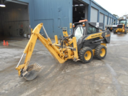 New Holland Skidsteer L170 with backhoe attachment and 4 in 1 bucket